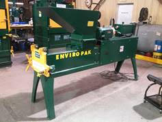 The Island Green Living Association new aluminum can compactor and baler